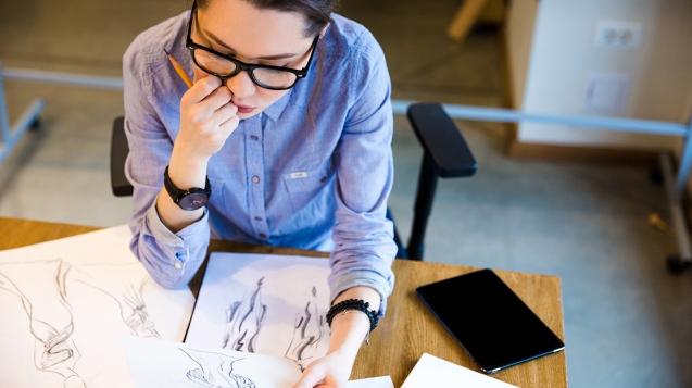pensive-woman-fashion-designer-sitting-and-PHGZYEM.jpg