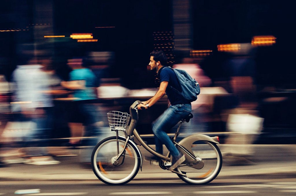 man riding electric bike with blurred background