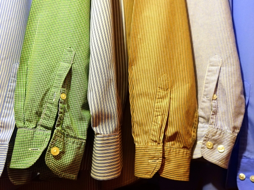 Different colored shirt sleeves that symbolize diversity