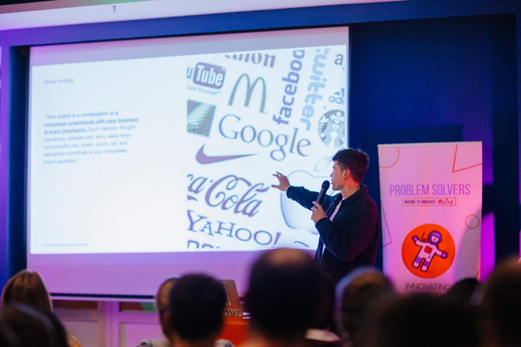 speaker talking about brand strategy while pointing to a screen
