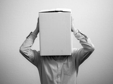 man with box over his head